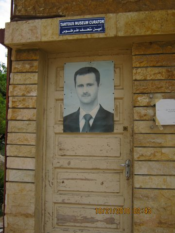 Assad on guardian's door of Tartous museum 2011