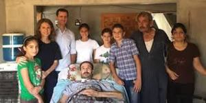 Asma & Bashar al-Assad with their three children and the family of a wounded soldier